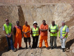 HG Health and Social Welfare Team with new Waste Cell in the background