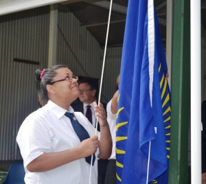 Student Vice-President Chrystabel Greentree Raises the Commonwealth Flag