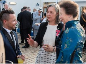 Neil meeting HRH The Princess Royal onboard the RMS in London